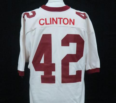 White football jersey, has Clinton and the number 42 on the back
