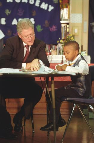 Bill reads with a student
