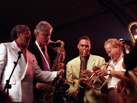 President Clinton plays saxophone with others